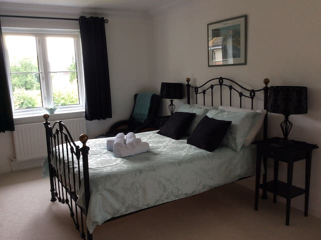 Private room not overlooked. Double bed, pillow top for extra comfort. Reclining chair and footrest. At end of bed are built in wardrobes, worktop, Smart TV.  No cushions to follow Covid rules.