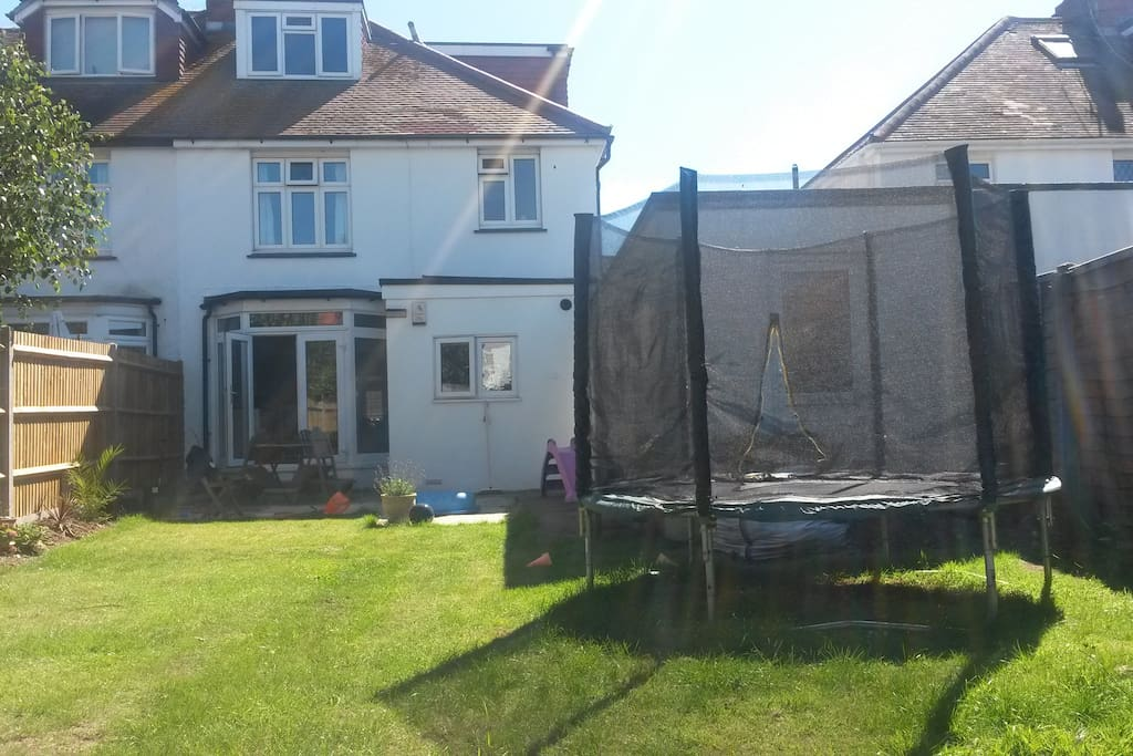 Large sunny west facing garden with 8ft trampoline