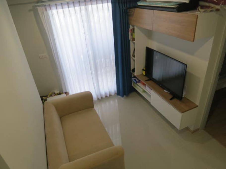 Lounge area with TV (can attach your laptop) and air con. Door goes out to balcony