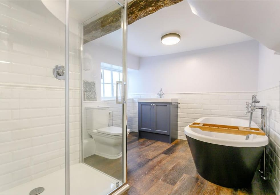 Private bathroom with Italian shower and free standing bath