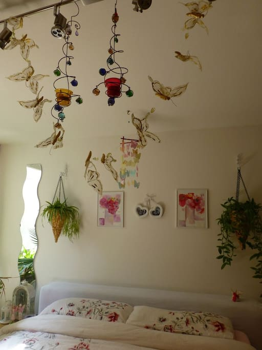 Butterflies fly over your bed.