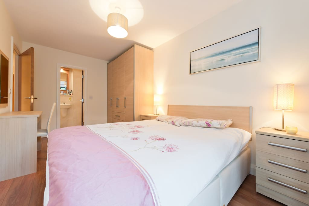 Master en-suite bedroom with access to balcony and Ensuited Bathroom