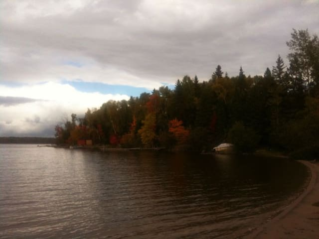 Dramatic view of nearby Wassi Lake public beach & swimming cove.