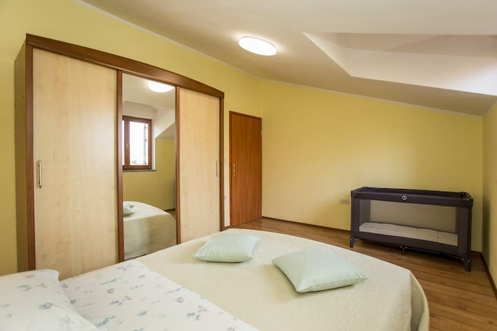 Bedroom 2 with AirCon and additional bed for toddlers.