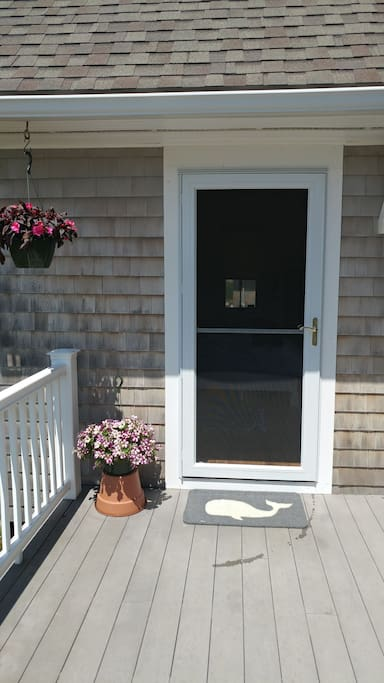 Your private entry on front deck. Gas grill and outdoor hot/cold shower.