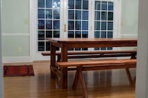 Dining room, just off the kitchen. Brand new Farm table can sit 10.