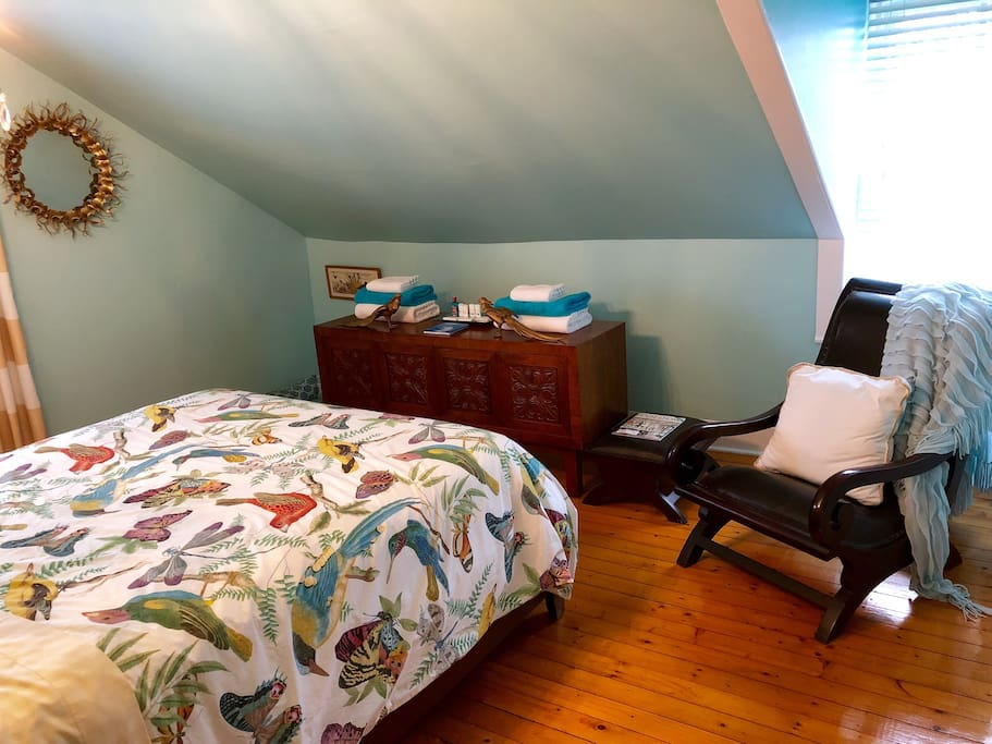 Turquoise Room has two bright windows and a comfortable plantation chair