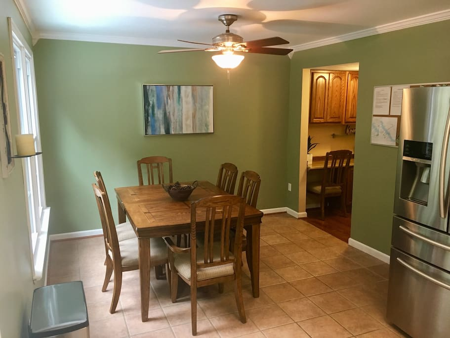 Large seating for up to 8 people (leaf and extra chairs in closet).  Also, there is a great view of the woods and backyard.