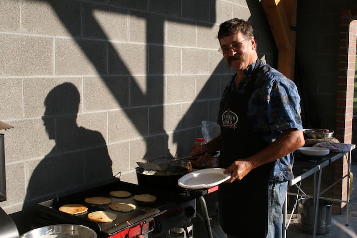 Bill loves to cook cowboy breakfast outside on the weekends
