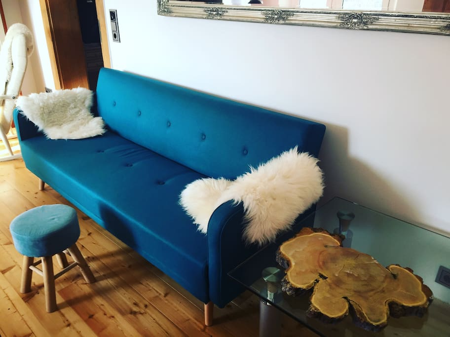 Cozy couch and real wooden floor (also usable as sleeping couch)