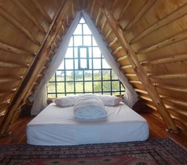Snug sleeping area that keep it simple ,elegant with a view of the lake, sunrise and sunset