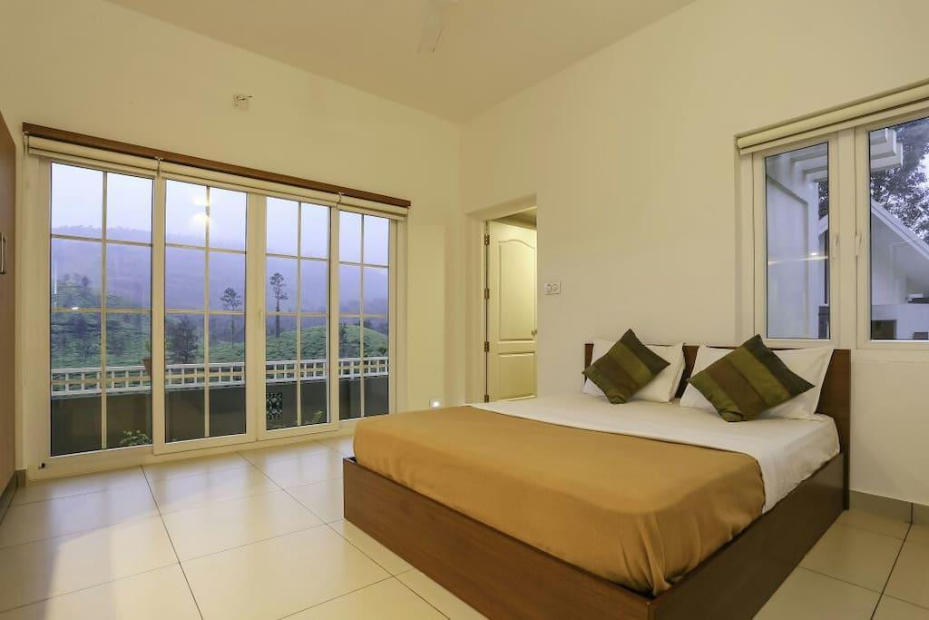 Bedroom with a spectacular view of the outdoors with a private balcony facing the Chembra peak!