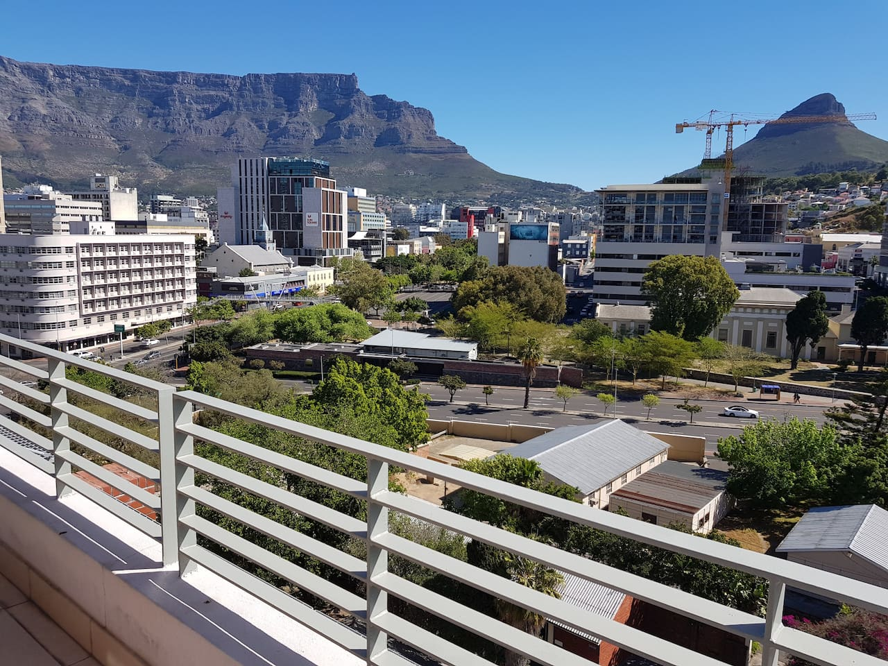 Your panoramic view from our 10th floor apartment to Table Mountain and Lion's Head.