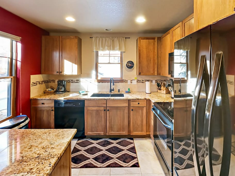 The well-stocked kitchen includes a starter supply of kitchen amenities (dish soap, paper towels) for your convenience.