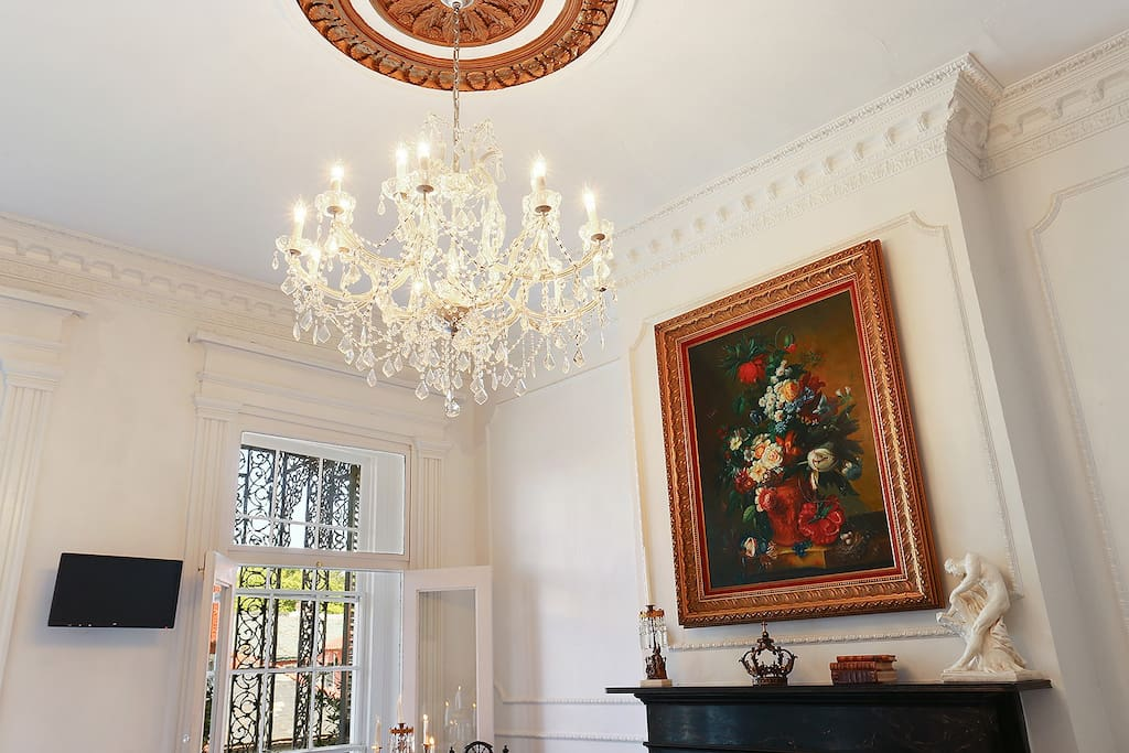 Original plaster ceiling medallion and French Crystal Chandelier and antique art adorned this elegant loft