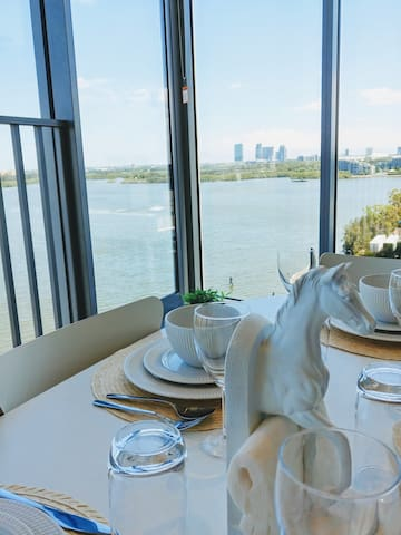 A dining area with the spectacular water & city view