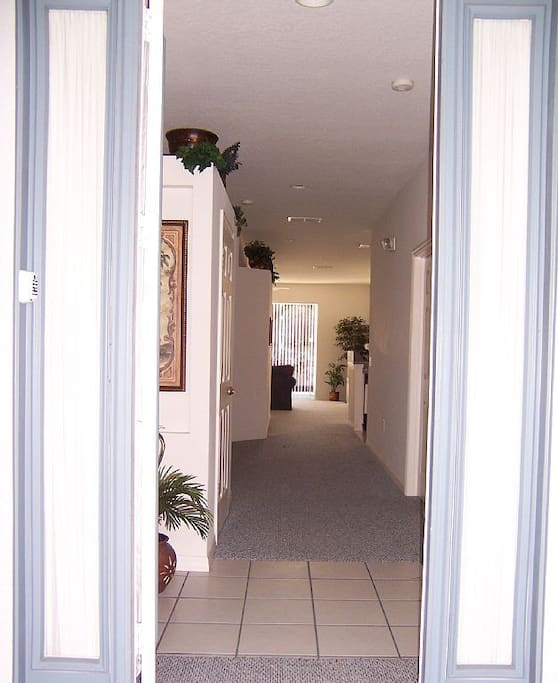 Hallway to family rae and dinning