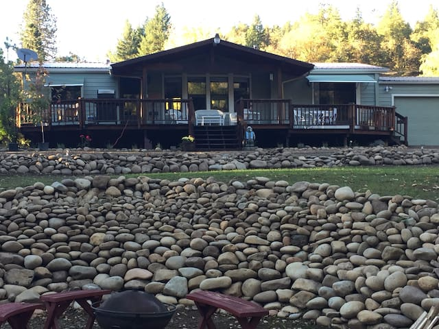 View of house from river and fire pit area
