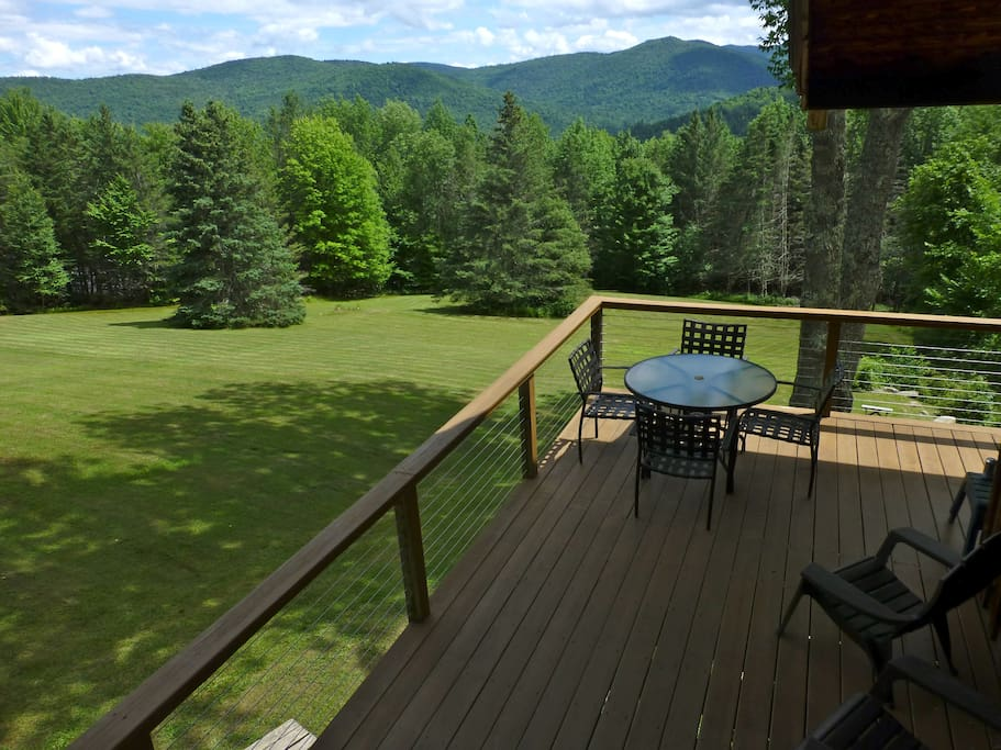Wrap around porch overlooking the meadow & the mountains