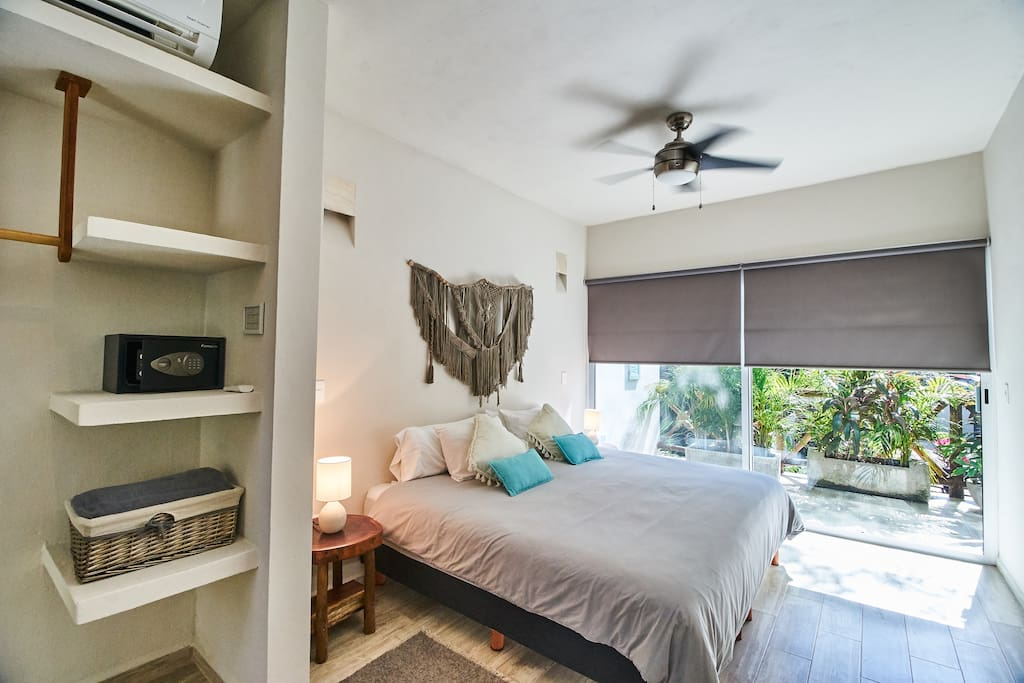 King size bed, cotton linen, AC, ceiling fan, blackout, safety box and a mirror door is what you will find in the room.