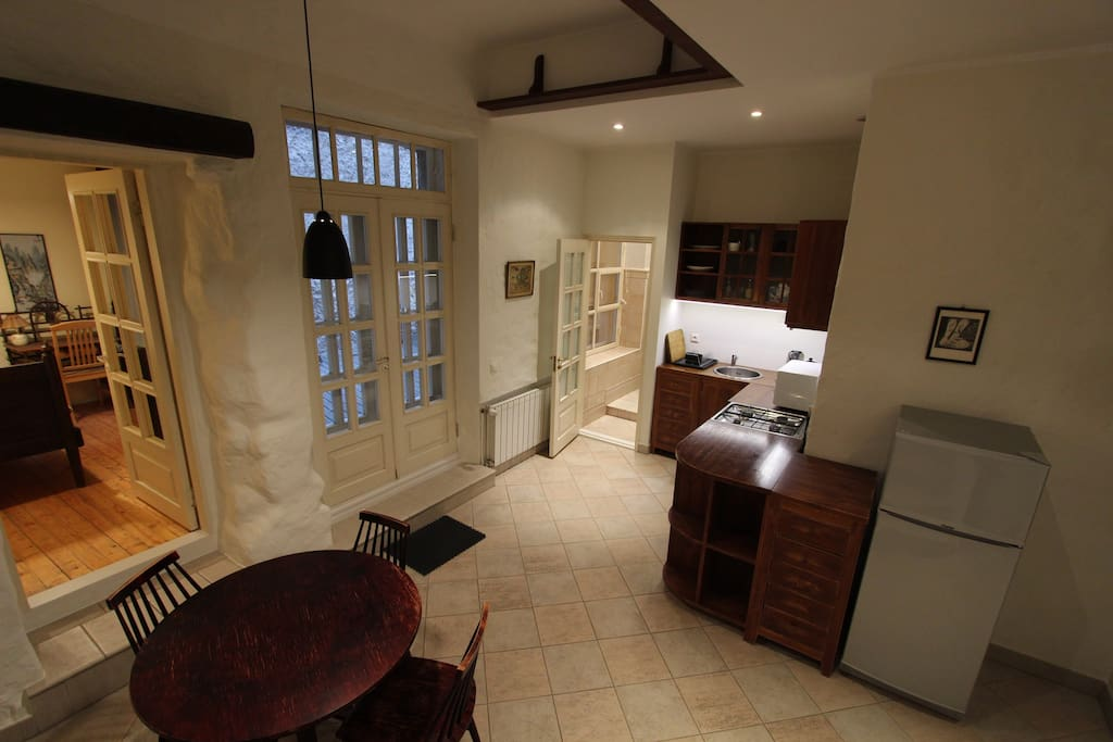 Panorama of the kitchen and dinning area. Second small bedroom and terrace entrance on the left of the photo.