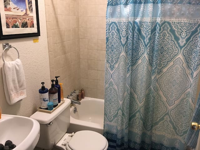 The shared bathroom has liquid soap, shampoo and conditioner for you.