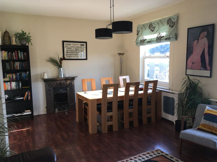 Which has a large dining table by the window