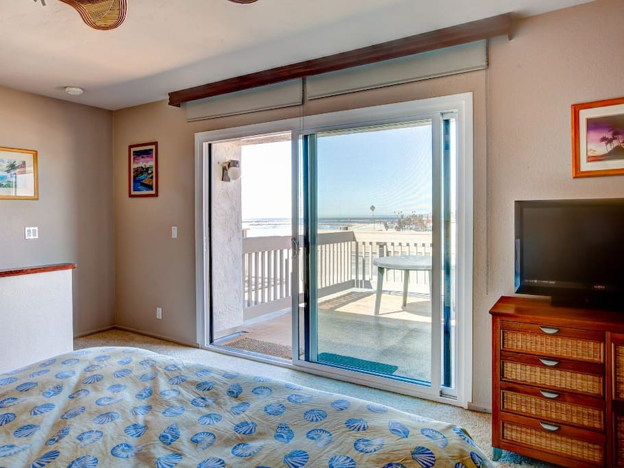 Upstairs bedroom with large ocean view patio