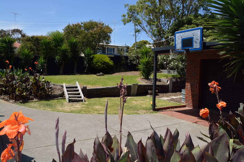 Front Garden area with plenty of grass to let the kids run free or pull up a picnic rug and relax amongst the shade of the trees.