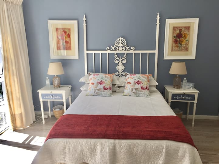 Sun filled and spacious bedroom with en suite