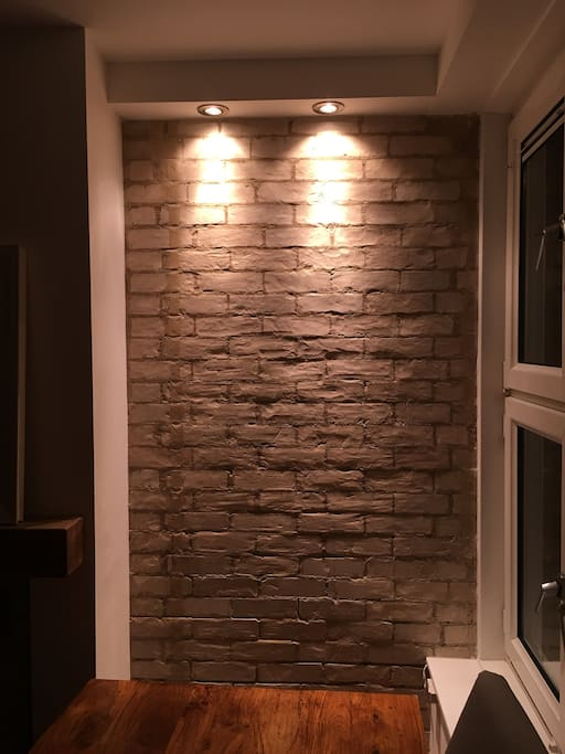 Original brick work looks amazing at night!