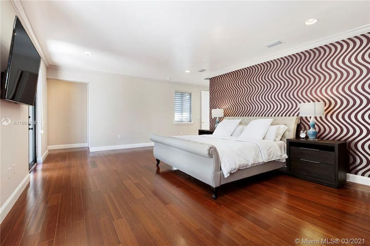 Master bedroom with 60 inch smart tv