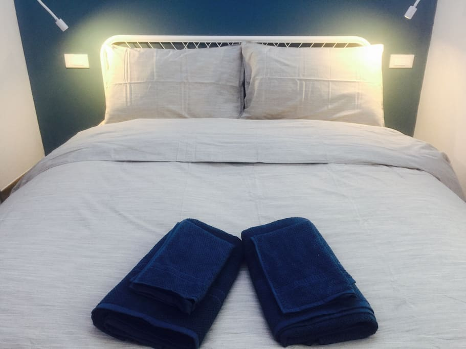 Comfortable bed with reading lights