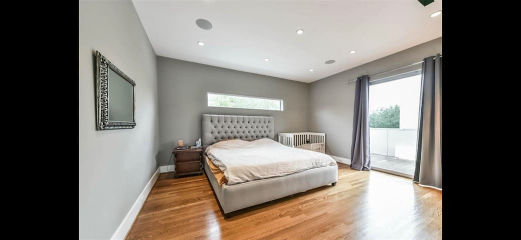 Huge Master bedroom with access to balcony