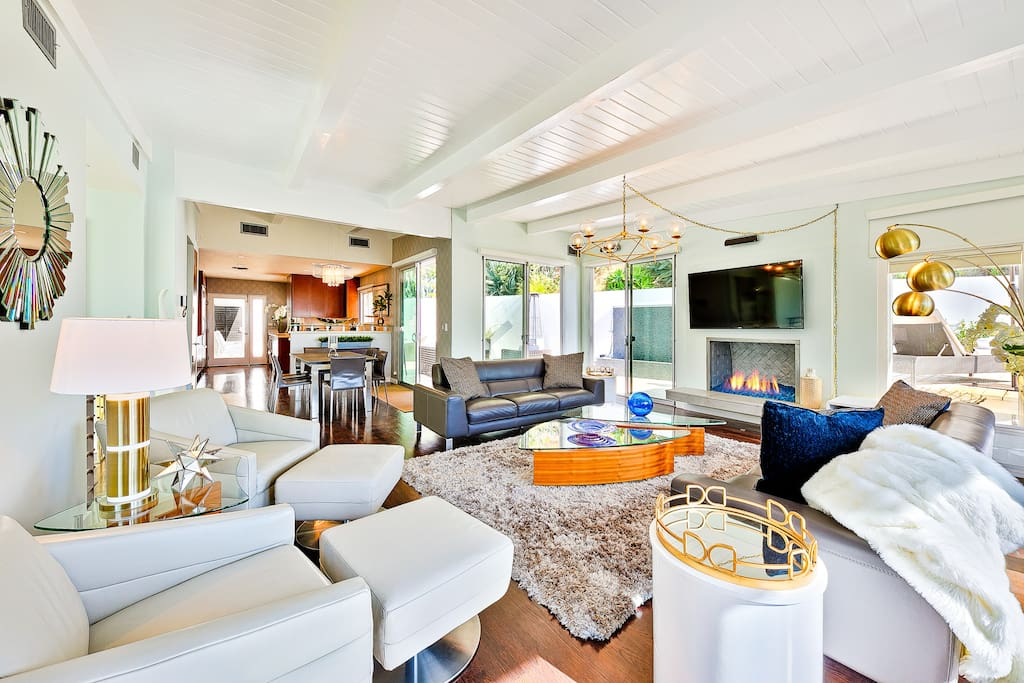 Another living room view with whimsical pops of colors visible.