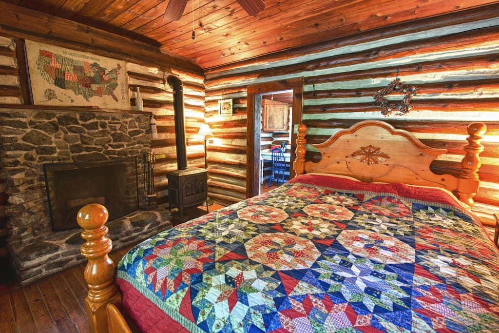 Sleepy Susan cabin with wood burning fireplace, gas log stove, queen bed and full kitchen.