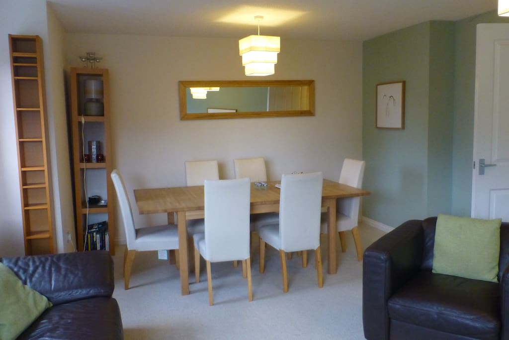 Lounge with very comfy, large leather sofa, chair and dinning table for 6.