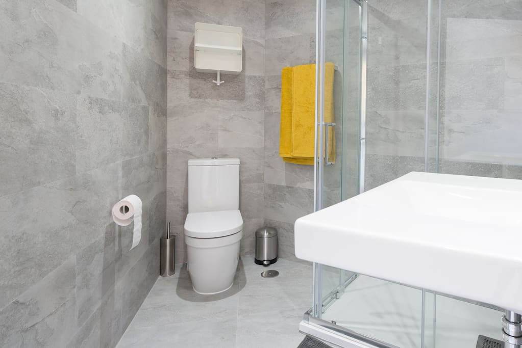 Modern bathroom. Towels are provided during your stay