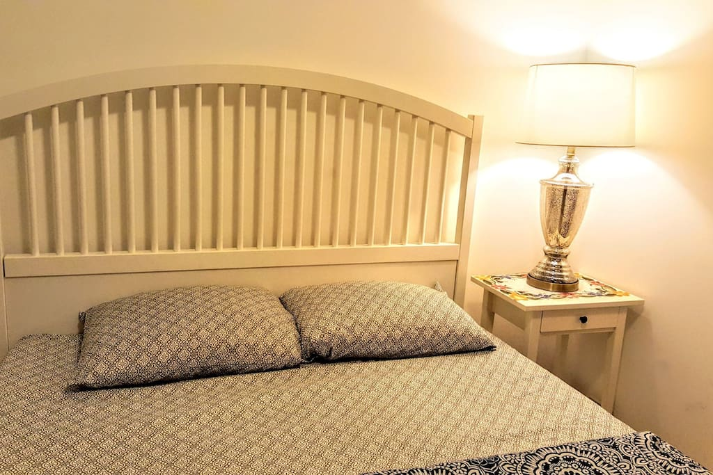 This is exactly how you will find your bedroom upon checking in. Sheets, blanket and towels are provided. Mattress is GREEN TEA MEMORY FOAM. There is a full sized mirror in your room!