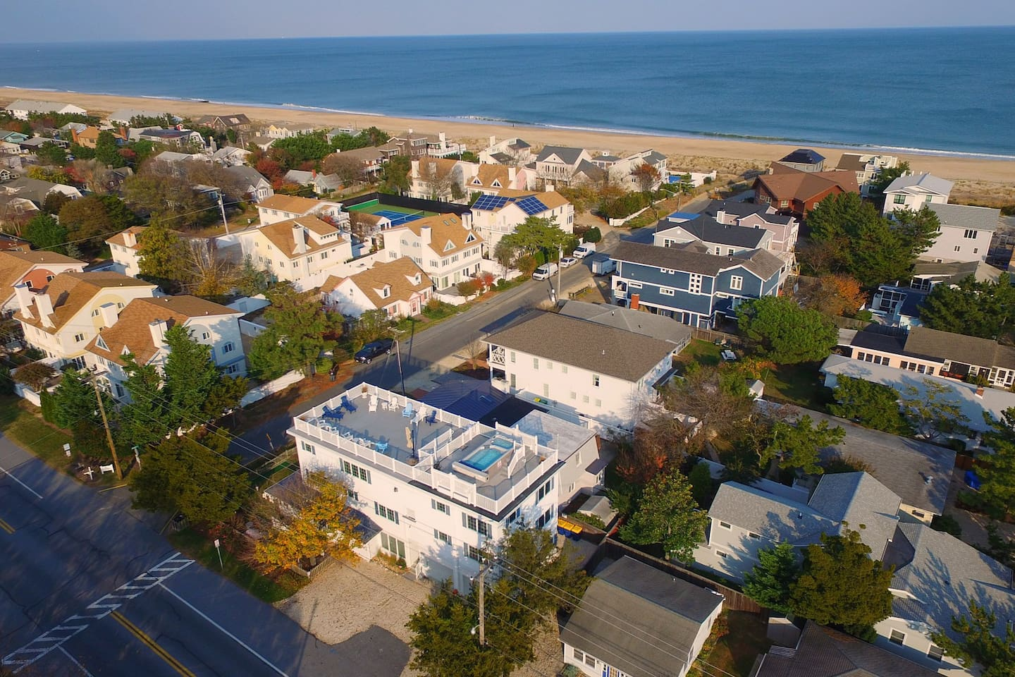 Aerial view of Memories highlighting the rooftop deck overlooking the Ocean with the heated pool and hot tub!