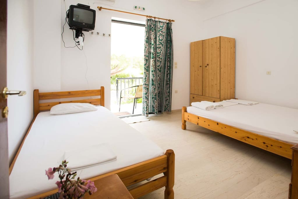 The room offers two beds, one double and one single