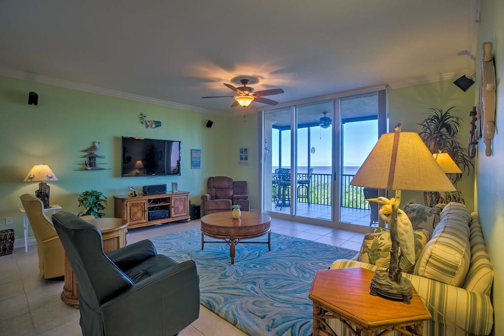 The bright and breezy living area has furnishings & a flat-screen cable TV.