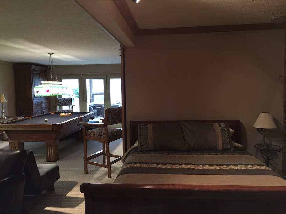 Queen bed and pool table
