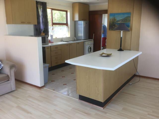 Full kitchen with stove,fridge and washing machine