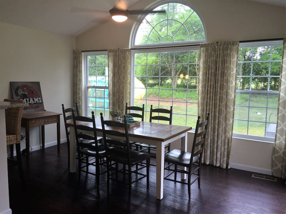 Dining Room/Sun Room with wooded views and lots of light!