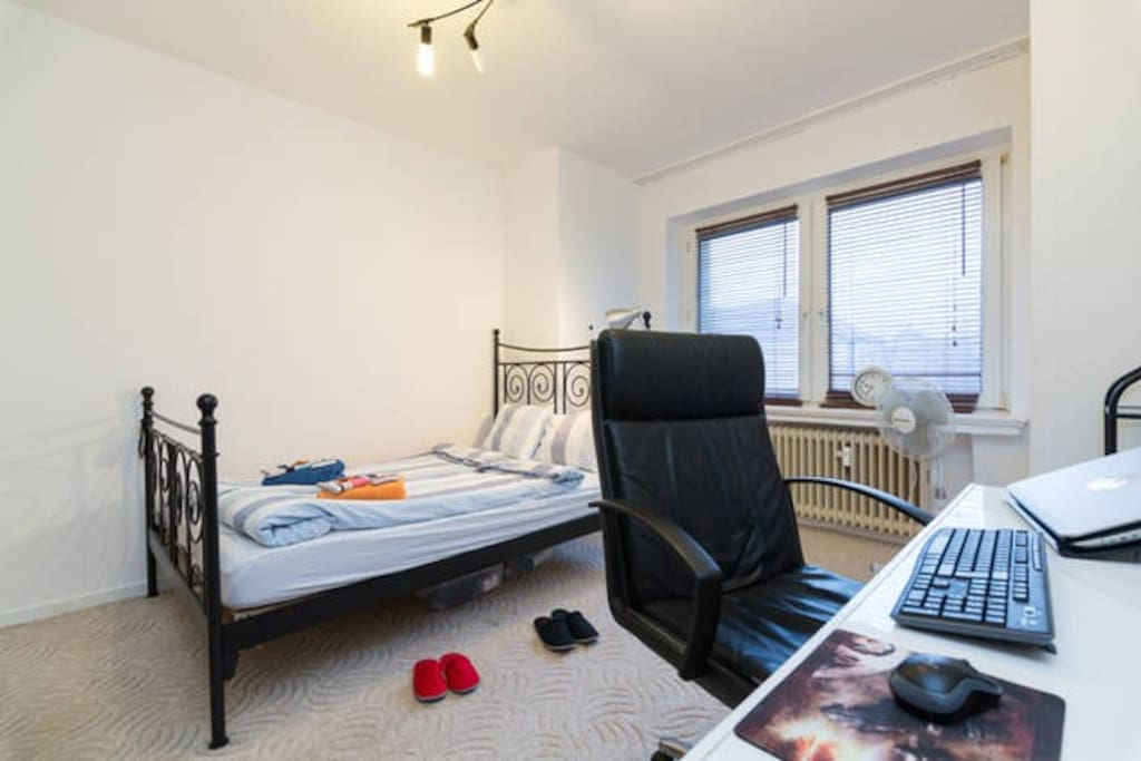 Bedroom with double bed and working space