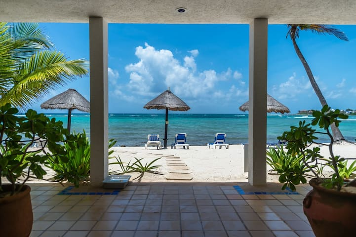 Beachfront with palapas