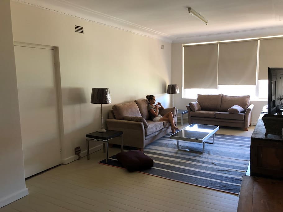 "Lounge room area with large 55"" Samsung LED TV"