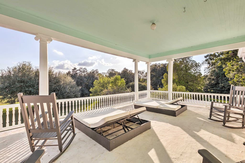 The property features a beautiful porch as well as a second floor balcony.