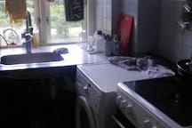 Kitchen. Washing machine is not free for airbnb guests.